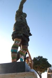 Youbin yarnbombing a Roman sculpture.
