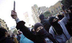 Egyptian woman protester holds up a knife