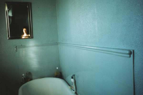 "Nan Goldin, ""Self-portrait in blue bathroom"" London 1980"