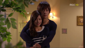 "An example of the infamous back-hug from the Korean drama ""Playful Kiss."""